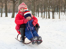 Two happy kids on the sled Stock Photo