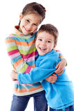 Two happy kids standing together Royalty Free Stock Photos