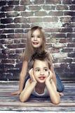 Two happy kids in studio Stock Photos