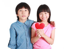 Two happy kids with valentines heart Stock Photography