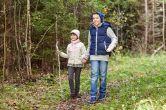 Two happy kids walking along forest path royalty free stock photo
