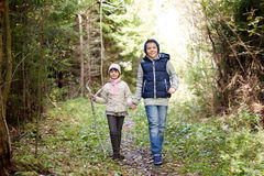 Two happy kids walking along forest path Stock Photo