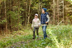 Two happy kids walking along forest path Stock Photography