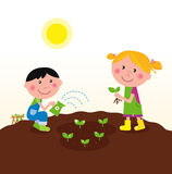Two happy kids watering and planting plants