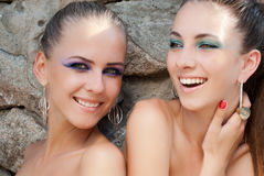 Two happy laughing young women fashion models Stock Photo