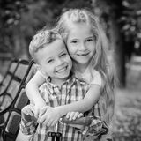 The older sister hugs her younger brother Royalty Free Stock Photo
