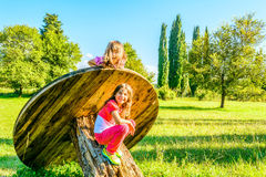Two happy little girl  playing in the park Royalty Free Stock Photos