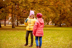 Two happy little girls in autumn park Royalty Free Stock Photo