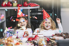 Two happy little girls child celebrating a birthday with cake at Royalty Free Stock Image