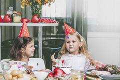 Two happy little girls child celebrating a birthday with cake at Royalty Free Stock Photo