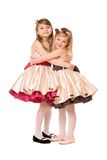 Two happy little girls in a dress. Isolated Stock Photo
