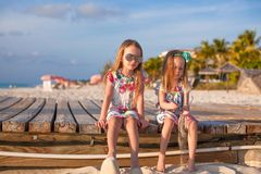 Two happy little girls enjoy vacation on white Royalty Free Stock Photo