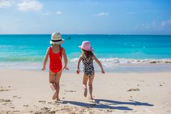 Two happy little girls enjoy vacation on white Stock Images
