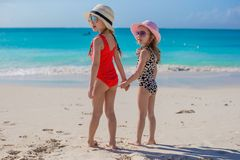 Two happy little girls enjoy vacation on white royalty free stock photography