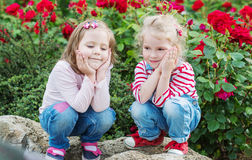 Two happy little girls playing Royalty Free Stock Photography