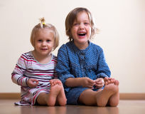Two happy little girls Stock Image