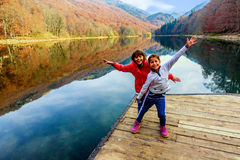 Two happy little girls  standing on the pier of Lake Biograd (Bi Stock Photo