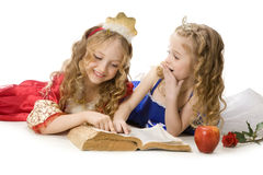 Two Happy Little Princesses Reading a Magic Book Stock Images