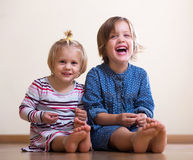 Two happy little sisters Stock Images