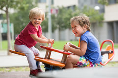 Two happy little sisters on teetering board Royalty Free Stock Photography