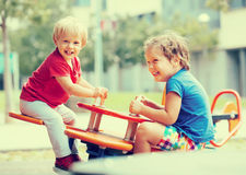 Two happy little sisters on teetering board Stock Image