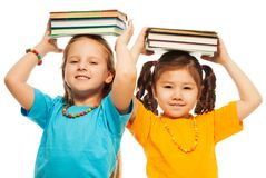 Two girls with books Royalty Free Stock Photo