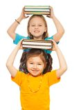 Smart girls with pile of books Royalty Free Stock Images