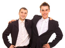 Two happy men. In suits isolated on white stock photos