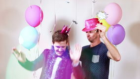 Two happy men dancing with props in photo booth stock video