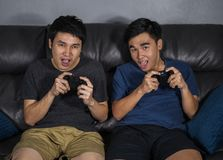 Two happy man playing video games royalty free stock images
