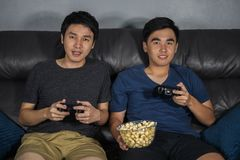 Two happy man playing video games stock images