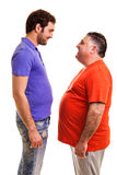 Two happy men standing face to face Stock Photo