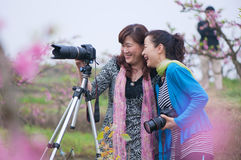 Two happy mother shooting Stock Photography