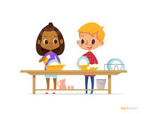 Two happy multiracial kids washing dishes isolated on white background. Children cleaning tableware. Montessori engaging education