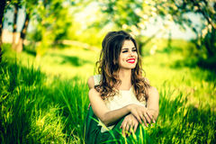 Two happy pretty girls sitting on the green grass Royalty Free Stock Images