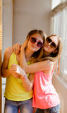 Two happy pretty teenage girls in sunglasses Royalty Free Stock Photo