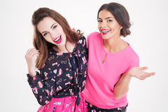 Two happy pretty young women standing and hugging Royalty Free Stock Photography
