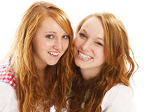 Two happy redhead bavarian dressed girls. On white background Royalty Free Stock Images