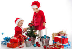 Two happy santa helpers Stock Images