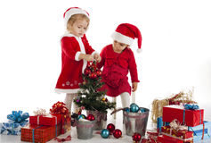 Two happy santa helpers Royalty Free Stock Photography