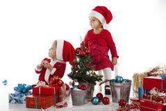 Two happy santa helpers Royalty Free Stock Photo