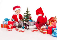 Two happy santa helpers. Over the white stock photos