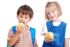 Two happy school children eating an apple Royalty Free Stock Photography