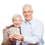 Two happy senior people holding Stock Photos