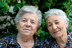 Two happy senior women. Portrait of two smiling and happy old ladies Royalty Free Stock Image