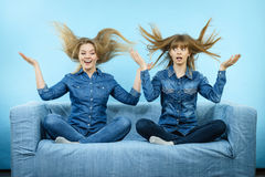 Two happy shocked women with windblown hair Royalty Free Stock Photography