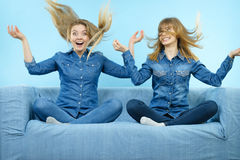 Two happy shocked women with windblown hair Stock Photo