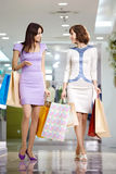 Two happy shopaholics Royalty Free Stock Images