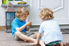 Two happy sibling boys having fun together outdoors Royalty Free Stock Photo