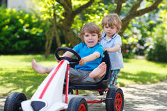 Two happy sibling boys playing with toy car Royalty Free Stock Photography